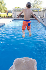Joshua Pool Jump (aaronrhawkins) Tags: jump pool water platform swimming dive splash neighborhood boy child joshua summer rock aaronhawkins
