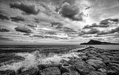 September evening (Vest der ute) Tags: fav25 fav200 monochrome sea seascape spain rocks waves mountain sky clouds cloudscape seaspray