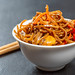 Macro shot of japanese soba with vegetables in sweet and sour sauce