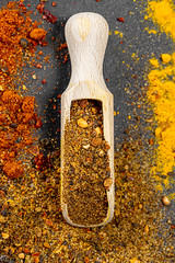 Top view wooden scoop with ground pepper mixture on spice background (wuestenigel) Tags: spice asian aromatic wooden old pepper vintage chili background spices red indian scoop paprika food colorful spicy seasoning powder turmeric curry black natural cuisine yellow ingredient kitchen noperson keineperson fall fallen pfeffer dry trocken wood holz desktop condiment würze würzen nature natur outdoors drausen essen hölzern cooking kochen leaf blatt color farbe ingredients zutaten pulver traditional traditionell bright hell 2019 2020 2021 2022 2023 2024 2025 2026 2027