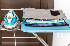 Electric iron with a stack of ironed clothes on blue ironing board (wuestenigel) Tags: electric clothing textile domestic closeup concept home background folded appliance board cotton household pile blue laundry housework iron cloth ironing clothes room noperson keineperson hausarbeit family familie wäsche furniture möbel towel handtuch wear tragen stilllife stillleben bookbindings buchbindungen clean reinigen travel reise retro indoors drinnen hotel color farbe library bibliothek wood holz school schule design job 2019 2020 2021 2022 2023 2024 2025 2026 2027