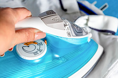 Close up hand of woman ironing clothes on ironing board (wuestenigel) Tags: electric clothing textile domestic closeup household home background folded appliance board cotton hand blue clothes laundry iron housework cloth ironing concept room noperson keineperson electronics elektronik diagnosis diagnose healthcare gesundheitswesen hausarbeit machinery maschinen equipment ausrüstung treatment behandlung therapie kur health gesundheit service bedienung plastic kunststoff medicine medizin family familie pulse impuls technology technologie isolated isoliert gerät wäsche emergency notfall sterile steril 2019 2020 2021 2022 2023 2024 2025 2026 2027