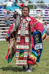 Robed in Cherokee fancy attire, a woman under the hot summer sun awaits the drums to start off the golden age class of the pow wow competition (sniggie) Tags: cherokee cherokeetrader cherokeedance hopkinsville kentucky nativeamerican powwow trailoftears trailoftearspark dancecompetition