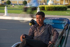 Medium View Cyclo Driver Waits for Customers with Passing Traffic Background (#3)