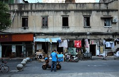 """China Wuhan old-town district near Xunlimen Station - """"Facade Fade"""" (moreska) Tags: china wuhan streetview xunlimen oldschool retro architecture structure faded crumbling urban decay motorbike vehicle outdoor gray tenement history downtown hubei province middle kingdom asia"""