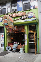 Trailer Park (Restless Eye) Tags: newyorkcity newyork usa trailerpark weird junk doorway entrance stuff signs shop bar
