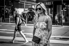 In the Summertime (Leanne Boulton) Tags: urban street candid portrait portraiture streetphotography candidstreetphotography candidportrait streetportrait streetlife woman female girl pretty face expression emotion mood feeling sunglasses beauty beautiful blonde hair dress summer summertime tone texture detail depthoffield bokeh naturallight outdoor light shade city scene human life living humanity society culture lifestyle people canon canon5dmkiii 70mm ef2470mmf28liiusm black white blackwhite bw mono blackandwhite monochrome glasgow scotland uk