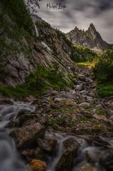 Alpine creek in Bernese Highlands (michaelreubi) Tags: waterfall stream creek river flow rocks water clouds moving movement motion alpine alps alpen mountains mountainrange peak peaks berneroberland bern berge hiking meiringen rosenlaui