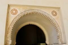 Door Arch Scrollwork (Piedmont Fossil) Tags: malaga spain alcazaba palace fortress door arch moor moorish decoration