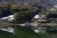 patches (blancopix) Tags: snow patches lake reflections grass hillside talus rock mountains nature