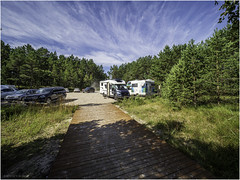 (Camper) parking (Luc V. de Zeeuw) Tags: camper motorhome parking rv trees ģipka rojasnovads latvia