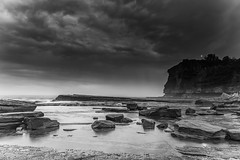 Moody Sunrise Rocky Seascape in Black and White (Merrillie) Tags: daybreak morning blackandwhite landscape theskillion waves nature dawn terrigal waterscape overcast water weather newsouthwales clouds earlymorning nsw sunrise sky ocean monochrome sea rocky coastal rocks outdoors seascape coast centralcoast cloudy australia