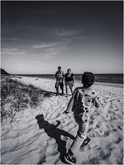 A day at the beach (Luc V. de Zeeuw) Tags: bw beach boy cloud coast coastline man sand sun tree water woman ģipka rojasnovads latvia