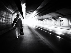 Way home (Sandy...J) Tags: olympus atmosphere atmosphäre alone blackwhite bw city contrast darkness fotografie germany photography light kontrast licht monochrom noir urban underpass unterführung tunnel street streetphotography sw schwarzweis strasenfotografie stadt blur blurred mood stimmung