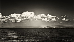 Clouds Over Athos (Alfred Grupstra) Tags: sea nature blackandwhite cloudsky sky water scenics cloudscape landscape outdoors seascape coastline sunset beach dramaticsky summer horizon beautyinnature horizonoverwater nopeople athos greece