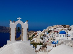 Oia August 2019 (lesleydugmore) Tags: oia santorini europe greece cyclonesisland building architecture houses outside outdoor blue sky colour bell church orthodox orthodoxchurch sea ocean aegean picturesque beautiful view