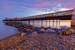 Daybreak Pier (Croydon Clicker) Tags: pier jetty rocks beach sky cloud daybreak dawn sunrise sunset sea ocean water longexposure pink hernebay kent nikon tokina