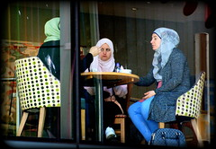 In an upstairs window (* RICHARD M (Over 9 MILLION VIEWS)) Tags: candid street window upstairs costa costacoffee portraits portraiture streetportraits streetportraiture candidportraits candidportraiture muslims muslimgirls seated sitting girlfriends headscarves table tableandchairs coffeeshop customers liverpool merseyside hijab hijabs scarves muslimwomen muslim islam ethnicity windows ethnic minoritygroups multiculturalism capitalofculture culture traditional traditions fashion fashions sidewaysglance