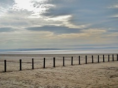 Somerset (Cat Thackstone) Tags: sea sky beach wooden seaside sand posts location filming sanditon