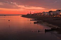 First Light (Croydon Clicker) Tags: dawn sunrise daybreak sunset sea lagoon water ocean beach groynes buildings lights sky cloud hernebay kent nikon sigma gobe