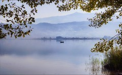 Early Autumn (PattyK.) Tags: ioannina giannena giannina epirus ipiros balkans hellas ellada greece grecia griechenland europe europeanunion whereilive lake pamvotida lakepamvotida ioanninalake lakeside lakefront waterfront bythelake fisherman nature autumn september water landscape landscapephotography ιωάννινα γιάννενα γιάννινα ήπειροσ ελλάδα βαλκάνια παμβώτιδα λίμνηπαμβώτιδα λίμνηιωαννίνων βάρκα ψαράσ ψάρεμα φθινόπωρο σεπτέμβριοσ τοπίο snapseed nikond3100