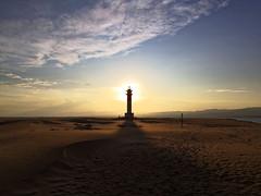 Sunlight behind the lighthouse (albertmcd) Tags: sunlight sunset lighthouse low light beach tarragona spain