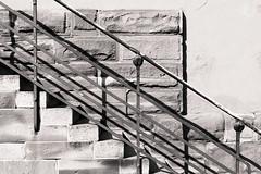 Level Up (dlerps) Tags: amount city daniellerps eu europe fr france frankreich french lerps photography sony sonyalpha sonyalpha99ii sonyalphaa99mark2 sonyalphaa99ii strasbourg summer urban httplerpsphotography lerpsphotography staircase stairs carlzeiss rail bannister planar5014za monochrome planart1450 bw wall diagonal down downstairs upstairs old carlzeissplanar50mmf14ssm