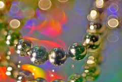 Bathtub Chain! (jesse1dog) Tags: bathtub chain spheres rainbowcolours vintageprime argus4 projectorlens tabletop macromondays junk mirror reflections bokeh lumixgm1