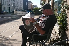 ... I read the news today, oh boy ... (ChristianofDenmark) Tags: christianofdenmark denmark copenhagen autumn sunshine street news read today oh boy outside coffee emmerys bar canon