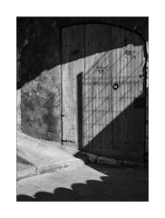 'the mystic door' (Armin Fuchs) Tags: arminfuchs nomansland sisteron door light shadow wood street niftyfifty anonymousvisitor thomaslistl wolfiwolf jazzinbaggies