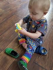 Exploring the camera (quinn.anya) Tags: eliza toddler camera alligatorshoes