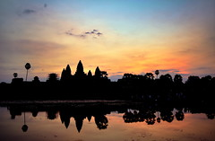 Beautiful sunrise by Angkor Wat ancient temple ruins, Cambodia (German Vogel) Tags: pond waterreflection sky silhouette galleriedtemple templemountain khmerarchitecture khmerempire 12thcentury hinduism travel tourism traveldestinations touristattractions famousplace cambodia asia southeastasia holidaydestinations siemreap siemreapprovince angkor unescoworldheritagesite cultures khmer architecture ancient ancientcivilization oldruin archaeology ruined sunrise morning early locallandmark nationallandmark buddhisttemple hindutemple buddhism