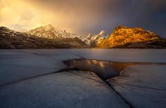 Below the Surface (Ryan Dyar) Tags: lofoten ryan dyar lake norway frozen winter ice reflection mountain mountains arctic norge sunset storm light clouds cracked cracks