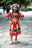 A young Chinese girl in a traditional attire, Puzhehei, Yunnan, China (adamba100) Tags: asia asian china chinese korea korean mongolia mongolian vietnam vietnamese thai beijing town city view landscape cityscape street life lifestyle style people human person man men woman women male female girl boy child children kid interesting portrait innocent cute charm pretty beauty beautiful innocence play face headshot pure purity tourism sightseeing tourist travel trip light color colour outdoor traditional cambodia cambodian phnom penh sony a6300 18105 siem reap pattaya bangkok field gate architecture tree building