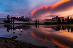 Caress of Mother Nature (TierraCosmos) Tags: mountain sunrise colorfulsky sky clouds lake sparkslake southsister brokentop cascades oregoncascades island trees reflection dawn goldenhour snowcapped landscape bestshotoftheday