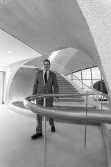 TWA Hotel_DSC7997 (GmanViz) Tags: gmanviz sonya6000 jetage architecture blackandwhite bw twahotel jfkairport newyork eerosaarinen midcentury modern stairway suit