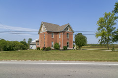 House — Richland Township, Darke County, Ohio (Pythaglio) Tags: house dwelling residence farmhouse historic ca1900 brick twostory gabledell 11windows jackarched bushes trees cables wires road richlandtownship darkecounty ohio stretcherbond