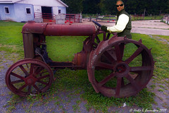 I'm channeling Oliver Wendell Douglas (Eddie Albert) from Green Acres.... (Fotofricassee) Tags: antique farmimplement agriculture farm tractor rust dilapidated man farmer