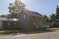 Harriman Log House — Castine, Ohio (Pythaglio) Tags: house dwelling residence historic twostory log singlepen overhangingplates remodeled altered vinylsiding 44windows sidewalk street castine ohio darkecounty harriman ca1835