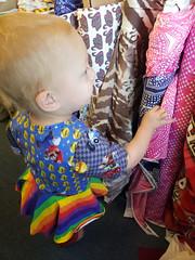 Eliza makes her choice (quinn.anya) Tags: eliza toddler fabric fabricstore stonemountaindaughter