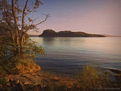 Inchcailloch Island (Rollingstone1) Tags: trees nature water island scotland natural outdoor shoreline hills shore lochlomond inchcailloch colour art artwork vivid peaceful tranquil balmaha sunset