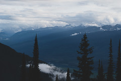 Revelstoke-Meadows-in-the-Sky-20 (_futurelandscapes_) Tags: mountains meadowsinthesky parkway trail revelstoke rockymountains bc britishcolumbia beautiful misty cloudy sunbeam view aerial above overhead vista borealforest alpine forest trees silhouettes sunset