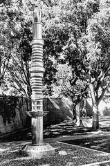 The Atomic Needle by Tony Price (Thomas Henneman) Tags: 35mm albuquerque black film monochrome newmexico oldtown white usa art sculpture ilford nikonfe2 museum atomicneedle tonyprice