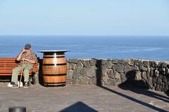 seaside bench (Hayashina) Tags: tenerife spain sea bench person barrel wall shadow hbm