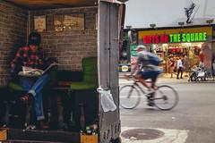 Inside Mel's Heart and Sole (Creekside Photog) Tags: newyork hellskitchen midtown shoe shoeshine kiosk gifeshop grain grit street bicycle movement people