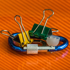 MacroMonday-Junk-23Sept19 (Patricia Wilden) Tags: 23sept19 ©patriciawilden eos70d junk macro macromondays sigmamacrolens ©patriciawilden2019 home indoor decoration fun metal gold orange blue yellow green clips