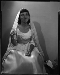 4x5-008-093058 (ndpa / s. lundeen, archivist) Tags: nick dewolf nickdewolf 1958 1950s film bw blackwhite photographbynickdewolf boston mass massachusetts people woman youngwoman bridal gown veil necklace pendant glass champagne champagneglass maggie portrait face brunette bride wedding weddingdress dress 4x5 largeformat blackandwhite sheetfilm late1950s