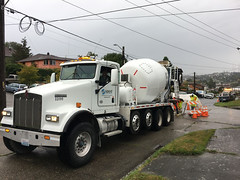 The Concrete Work Must Go On! Ready to roll on Beacon Hill (Seattle Department of Transportation) Tags: seattle sdot transportation bestofsdot concrete crew creative tarp rain traffic circle beacon hill bayview truck