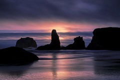 Sunset over sea stacks on Bandon Beach, Oregon (diana_robinson) Tags: sunset seastacks seascape ocean pacificocean sand surf waves rocks clouds sunburst peaceful nopeople remote bandonbeach oregon