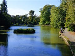 Little Boy Fishing (nannyjean35) Tags: lake boy water trees path leaves rod sky birds